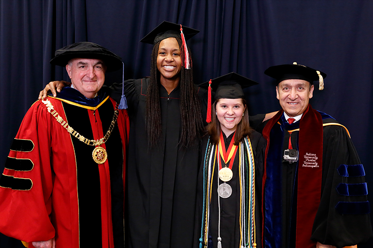 President Michael McRobbie, Chancellor Nasser Paydar, Amber Kriech, and the other commencement speaker.