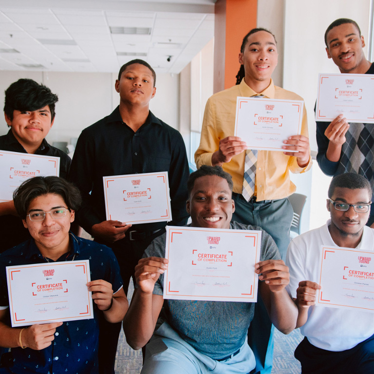 Upward Bound students receiving a certificate of completion.